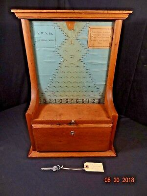 ANTIQUE S.W.V. Co. PENNY DROP TRADE STIMULATOR MACHINE Cliftondale, Mass.