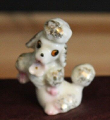 Vintage Miniature Poodle Sitting up Porcelain Figurine made in Japan