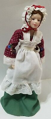 """Vintage 1987 Early American8.5"""" porcelain doll made by Avon"""