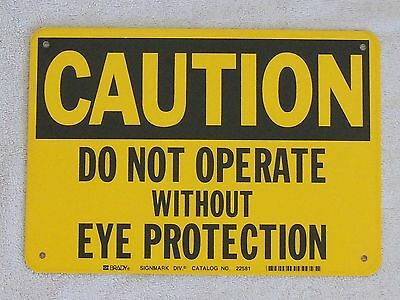 """CAUTION DO NOT OPERATE W/O EYE PROTECTION - 7"""" x 10"""" Plastic Sign Safety"""