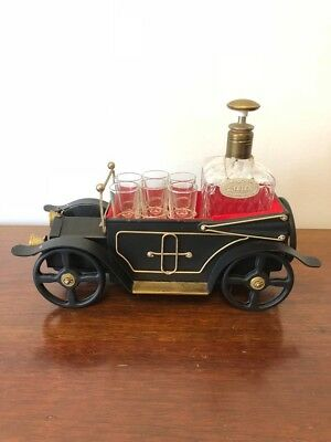 Musical Whiskey/Gin model car decanter and 4 shot glasses.