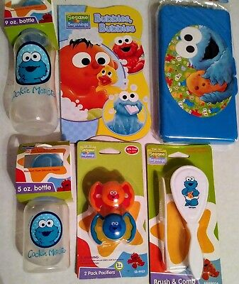 Sesame Street COOKIE MONSTER Baby Book Brush Wipe Case  Pacifiers & Bottle Set