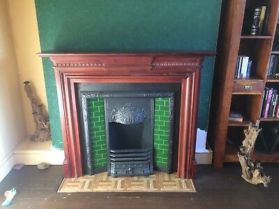 Victorian style Fireplace with Ceramic Tiled Trim and Wood surround