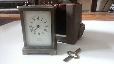 French Antique brass cased carriage clock with traveling case