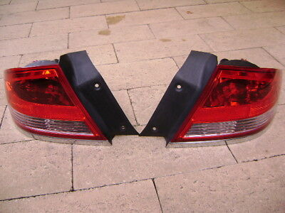 Ford BF  right  and left hand tail lights  genuine ford