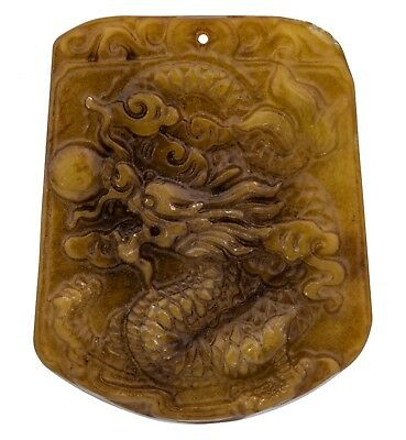 A Yellowish Green Hard Stone Chinese Dragon Decorated Pendant