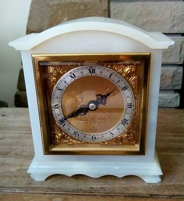 white Onyx mantel clock made by Elliott good working condition