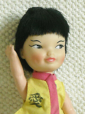REMCO INDUSTRIES INC.- VINTAGE KARATE POCKET DOLL w. BELLY BUTTON ACTION ARM