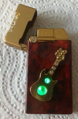 Cigarette Lighter With Guitar And Light On Brown Color Combined With Gold