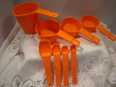 NICE ORANGE MEASURING CUPS w/A POUR SPOUT & A SET OF TUPPERWARE MEASURING SPOONS