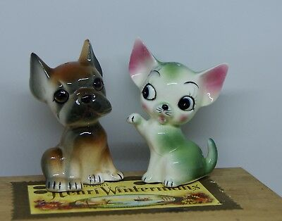 Cute vintage kitsch dog and cat salt and pepper shakers.