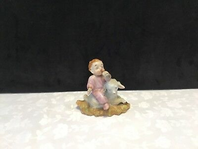 Vintage porcelain Baby w/horn on a spaghetti lamb figurine Japan (G82)