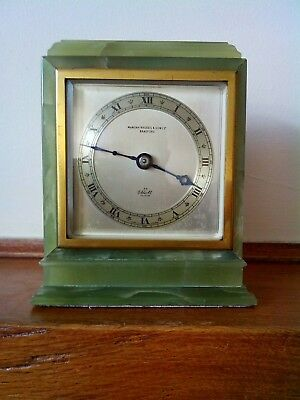 green onyx mantel clock made by F. W elliott in excellent condition.