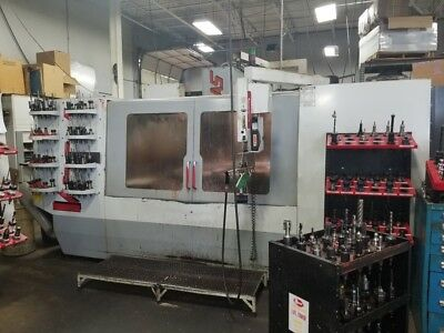 Used Haas VF-7 CNC Vertical Machining Center Mill CT40 32 Tool  VMC Machine 1999