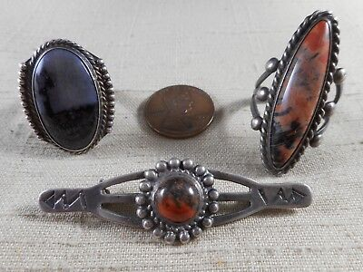 Collection of silver & petrified wood FRED HARVEY era Navajo jewelry