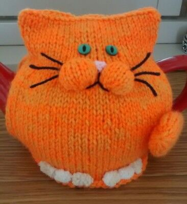 Hand-knitted Jack the ginger cat tea cosy.