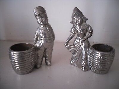 A Pair Of Silver Plated Dutch Figures Girl & Boy Each With A Basket