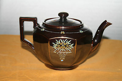 Brown Japanese Teapot and Lid with Embossed Floral Design Redware