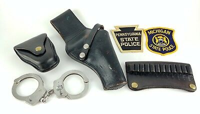 Vintage Smith & Wesson Handcuffs And Jay-Pee Revolver Holster With Accessories.