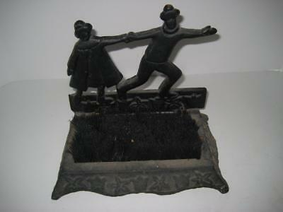 Rare Vintage Cast Iron Boot Brush / Scrapper ~ Young Couple of Ice Skaters