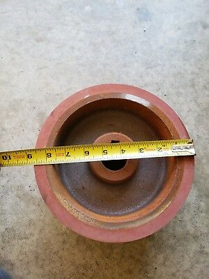 "New old stock drive wheel 8-5/8"" O.D. rubber coated."