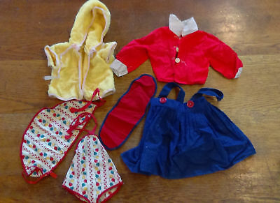 lot of vintage baby doll clothes, blue skirt, red shirt, yellow robe baby outfit