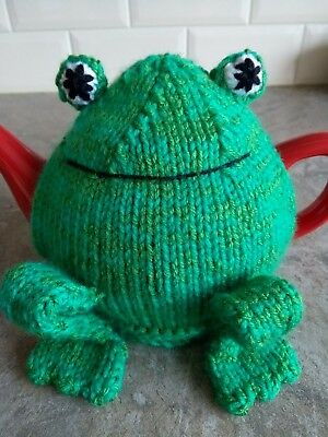 Hand-knitted Freddie Frog tea cosy. Fits medium sized teapot.