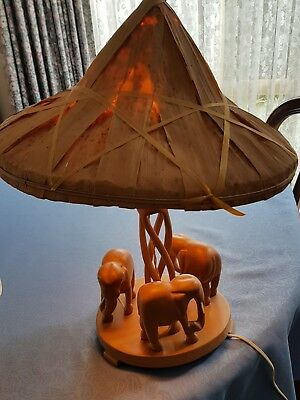 Table lamp with wooden elephants and shade. 47cm to top of shade. Includes globe