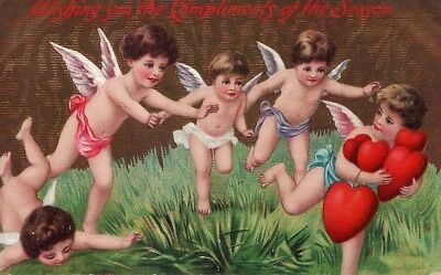 Early Christmas Postcard with Little Angels and Hearts, Used