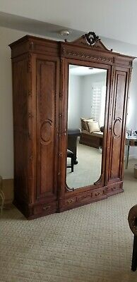 "Mahogany colored French 93"" high armoire with adjustable interior shelves"