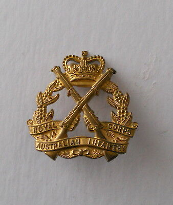 RAINF 1960-75 Australian Army hat badge Brass Both Lugs Intact.