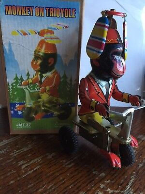 Wind up Tin Toy  Monkey on a Bike new