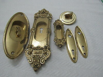 Antique various solid brass key holes and more pieces