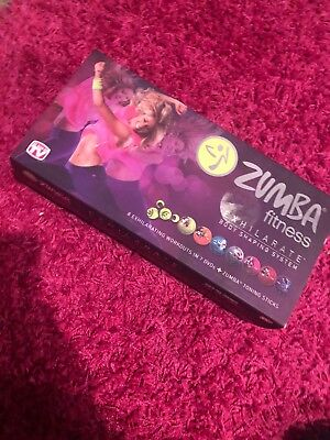 Zumba Exhilarate Work Out - 7 DVD's, Toning Sticks & Programme Guide