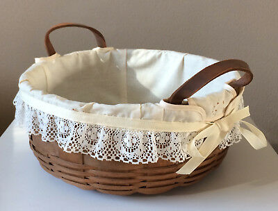 """5500-J Longaberger 1984 10"""" Basket with lace cloth liner and leather handles."""