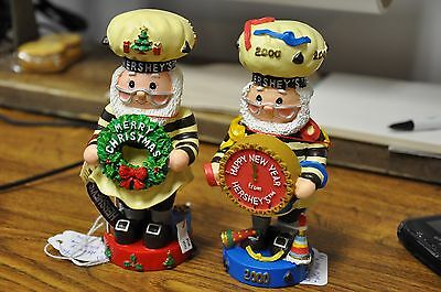 "Hershey's 5.5"" Elf Figurines Lot - 2001 Merry Christmas Wreath and 2000 New Year"