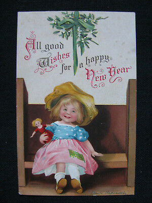 1908 New Year postcard~ A/S Ellen Clapsaddle girl sitting on bench with doll