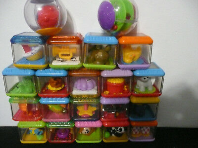 Lot 21 Fisher Price Peek A Boo Blocks and Roll Around Balls
