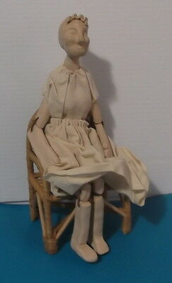 Antique Hand Crafted Clay Caricature Old Lady in  Rattan Chair