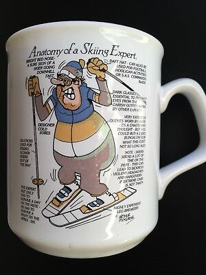 "White Mug Showing ""Anatomy of A Skiing expert"". Great Christmas Present."