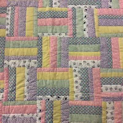 Handmade multi color baby quilt, flannel backed