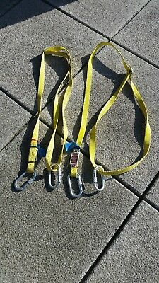two safety harnesses. Brand new