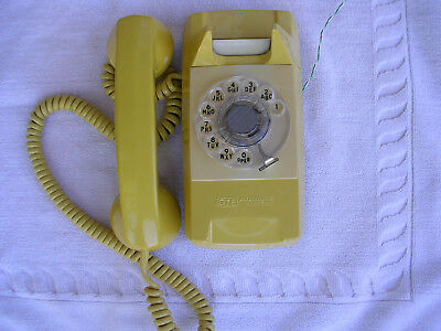 vintage Automatic Electric Starlite dial wall telephone, yellow, clean & working