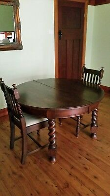 Antique jacobean extendable dining table with 2 chairs.