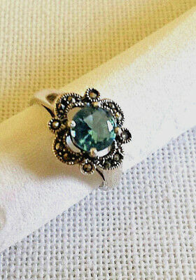 Marcasite and blue faceted stone in sterling silver cocktail ring marked 925