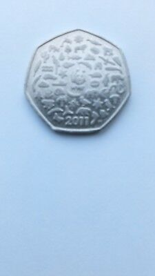The RARE WWF Minted 2011 50p COIN CELEBRATING 50 YEARS ago with panda logo on.