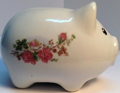 cute little pig piggy bank whit flowers painted each side