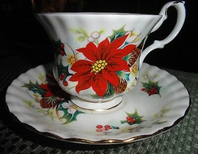 """Royal Albert """"POINSETTIA"""" Tea Cup and Saucer made in England"""