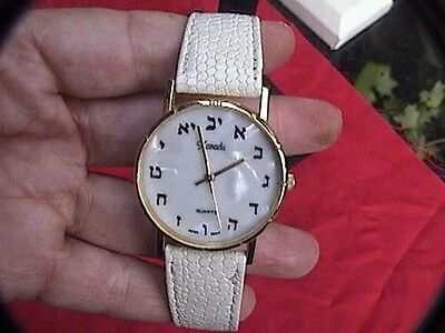 xanadu quartz analog watch with eastern numbers on the face mother of pearl look