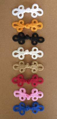 2 sets of hand-stitched frog fasteners closure trimmings black white and colours